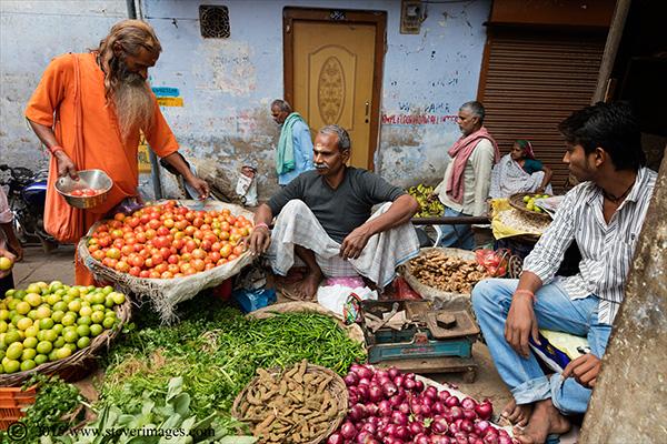 Hindu man, buying fruit, Market Varanasi India, photo