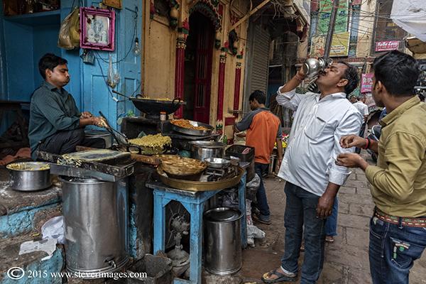 man drinking, market, Varanasi, India, photo