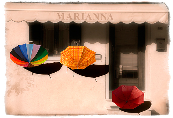 This image was taken in 2008. The sun had come out after some heavy rain, hence the umbrellas were left out to dry. I did quite...