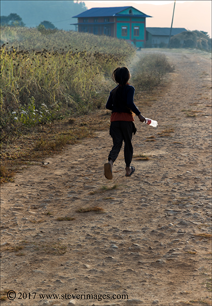 Child running, Nepal, photo
