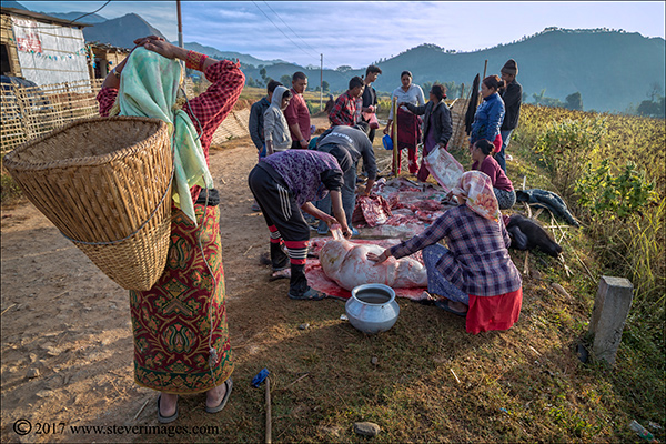 Nepal, outdoors, meat being cut up, photo