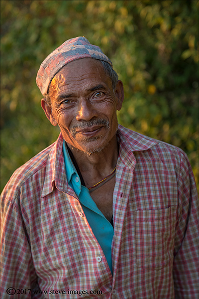 Portrait, outdoors, elderly worker, Nepal, Photo, outdoor portrait of elderly man in Nepal coming home from work.