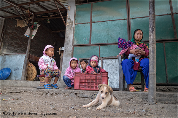 Picture of family outdoors with dog in Nepal., photo