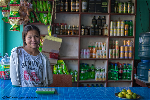 Portrait of young girl in roadside cafe, Nepal , photo