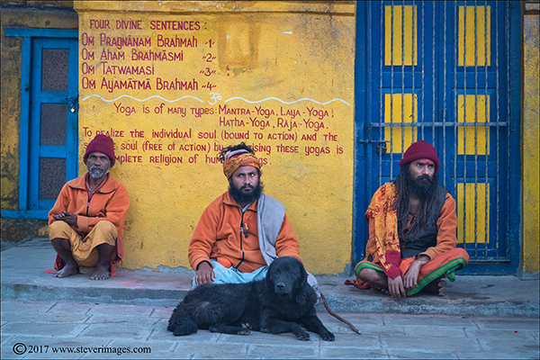 Three Hindu men at burning Ghat Nepal