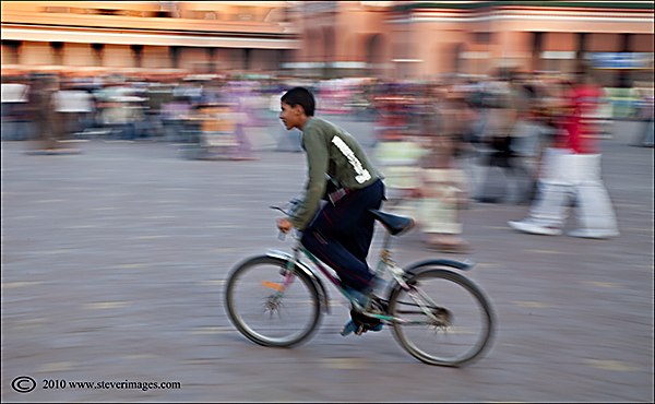 Djemaa-el-Fna, young biker, panned exposure, photo