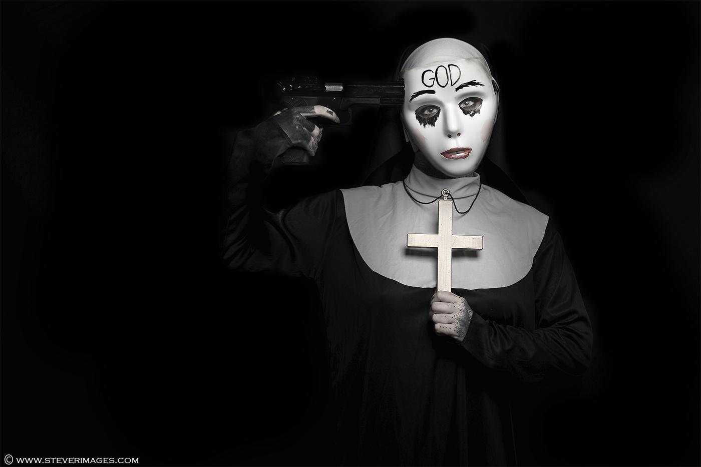 Suicide, mental health, gun, nun, female model, subdued colour, photo