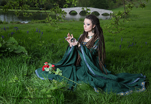Crystal ball, woman in green dress, red roses, photo