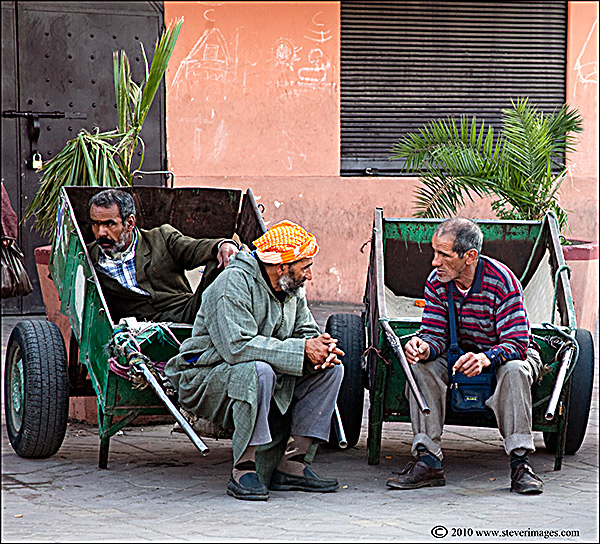 Another candid image from Djemaa-el-Fna square. I was drawn to the charactersin their wheel barrows. ...