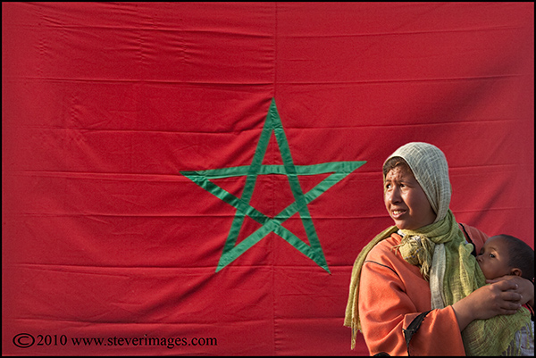 A composite image. There were numerous flags around the northern Morocco as the King was soon to visit. The woman and her...