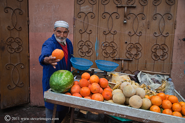 Taken late in the day, this gentleman was keen for me to buy one of his oranges.