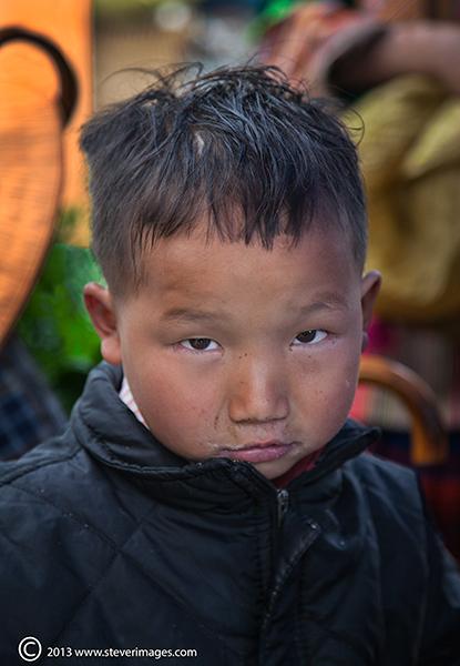boy portrait, Bac Ha market North Vietnam, photo