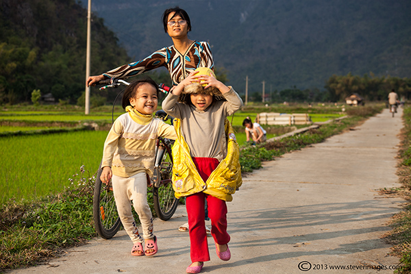 Children laughing, Mai Chau valley, North Vietnam, photo